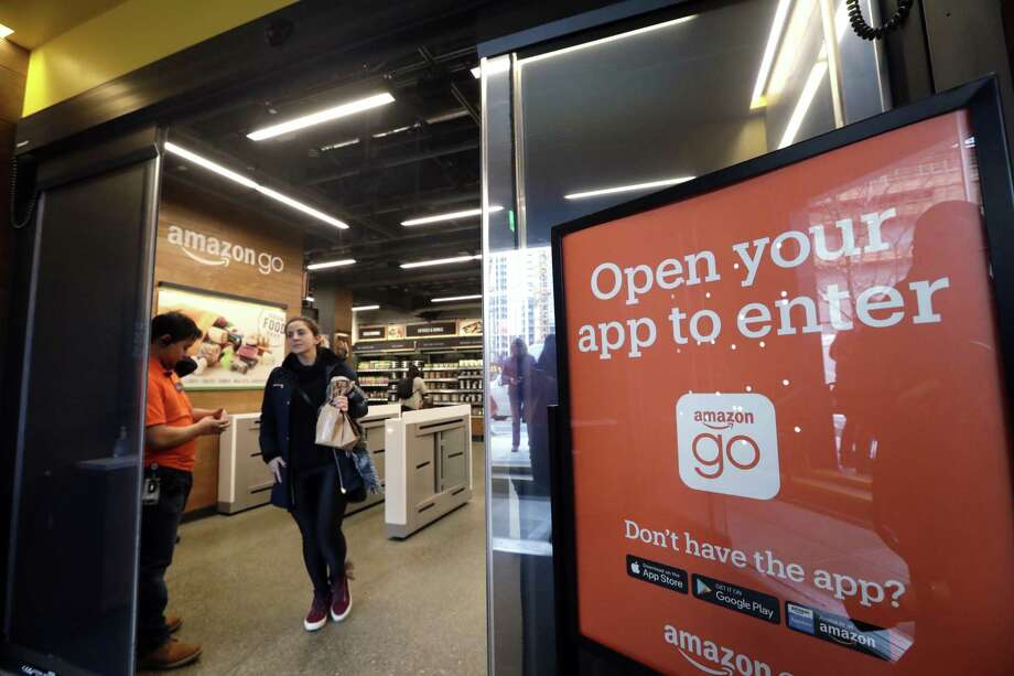 At an Amazon Go store, cameras track shoppers' every move and they are charged as they leave. Photo: Photos By Elaine Thompson / Associated Press / Copyright 2018 The Associated Press. All rights reserved.