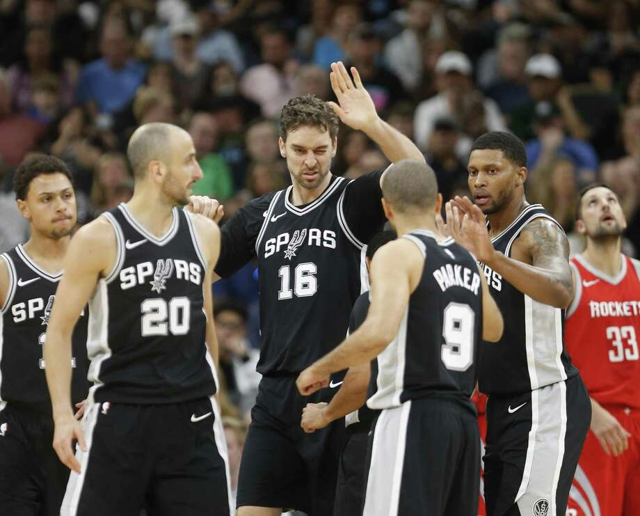 SAN ANTONIO,TX - APRIL 1 :  Pau Gasol #16 of the San Antonio Spurs high fives teammates after a basket against the Houston Rockets at AT&T Center on April 1 , 2018  in San Antonio, Texas.  NOTE TO USER: User expressly acknowledges and agrees that , by downloading and or using this photograph, User is consenting to the terms and conditions of the Getty Images License Agreement. (Photo by Ronald Cortes/Getty Images) Photo: Ronald Cortes, Stringer / Getty Images / 2018 Getty Images