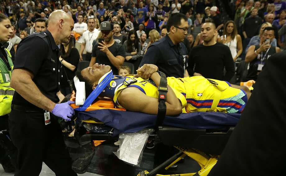 Golden State Warriors guard Patrick McCaw is taken off the court on a stretcher after falling hard to the floor late in the third quarter following a Flagrant 1 foul by Sacramento Kings's Vince Carter in an NBA basketball game Saturday, March 31, 2018, in Sacramento, Calif. The Warriors won 112-96. (AP Photo/Rich Pedroncelli) Photo: Rich Pedroncelli / Associated Press