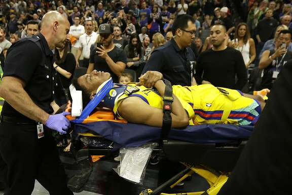 Golden State Warriors guard Patrick McCaw is taken off the court on a stretcher after falling hard to the floor late in the third quarter following a Flagrant 1 foul by Sacramento Kings's Vince Carter in an NBA basketball game Saturday, March 31, 2018, in Sacramento, Calif. The Warriors won 112-96. (AP Photo/Rich Pedroncelli)