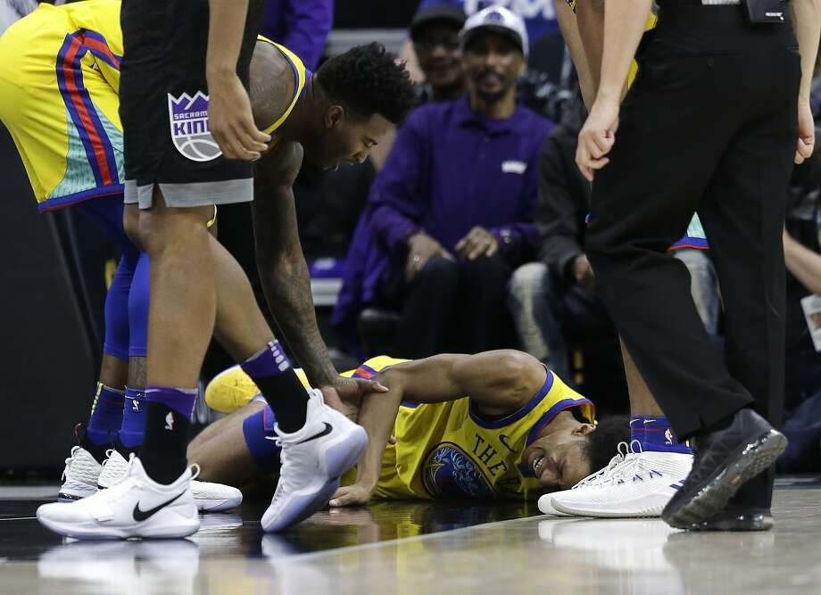 Golden State Warriors guard Patrick McCaw lays on the court in pain after falling hard to the floor late in the third quarter following a Flagrant 1 foul by Sacramento Kings's Vince Carter in an NBA basketball game Saturday, March 31, 2018, in Sacramento, Calif. McCaw was taken off the court on a stretcher. The Warriors won 112-96. (AP Photo/Rich Pedroncelli) Photo: Rich Pedroncelli / Associated Press
