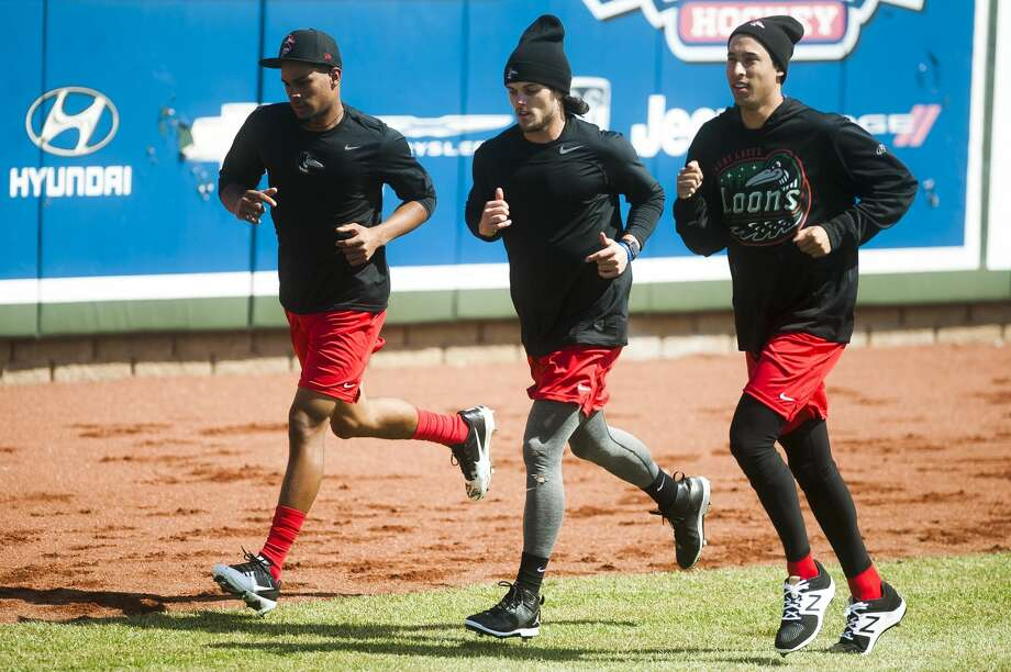 From left, Great Lakes Loons pitchers Melvin Jimenez, Riley Ottesen and Max Gamboa jog around the field during their first practice of the season on Monday, April 2, 2018 at Dow Diamond. (Katy Kildee/kkildee@mdn.net) Photo: (Katy Kildee/kkildee@mdn.net)
