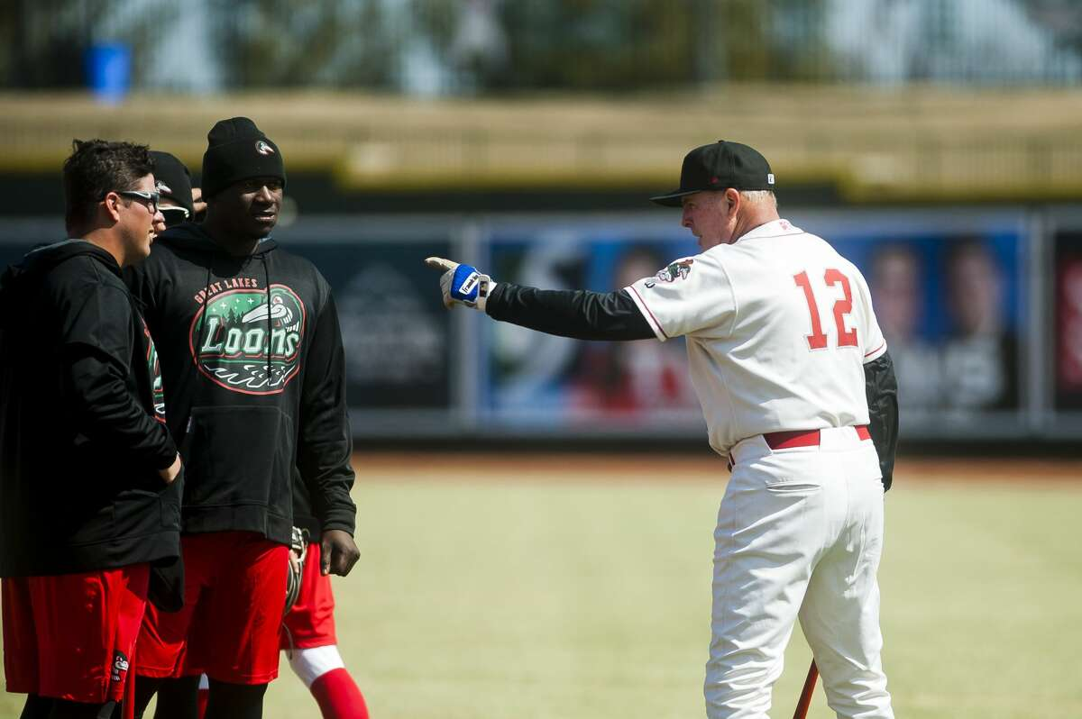 Great Lakes Loons Manager John Shoemaker works with players during their first practice of the season on Monday, April 2, 2018 at Dow Diamond. (Katy Kildee/kkildee@mdn.net)