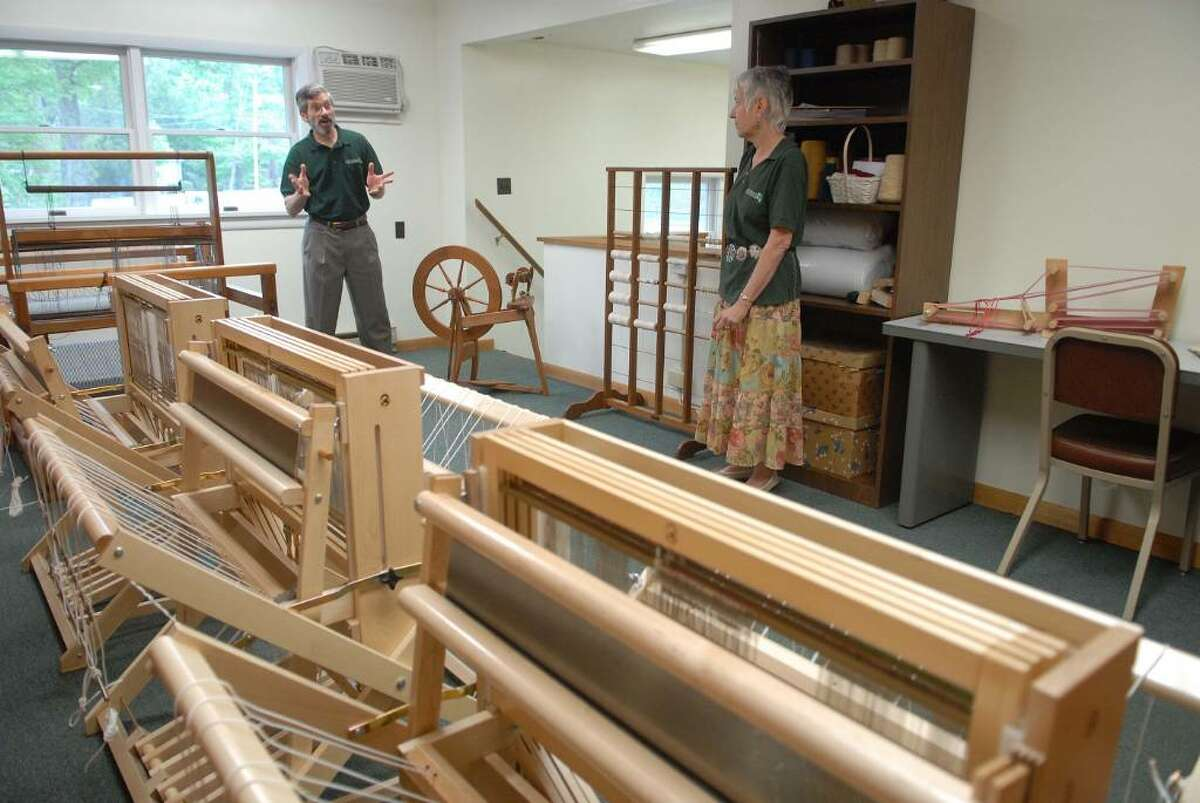 Jim Mandle, left, and Sandy Sherman, right, stand in the textile room near some hand looms during a tour of the Adirondack Folk School in Lake Luzerne, NY on Tuesday, May 4, 2010. The Adirondack Folk School will be dedicated to teaching the arts, crafts and culture of the Adirondack region. (Paul Buckowski / Times Union)