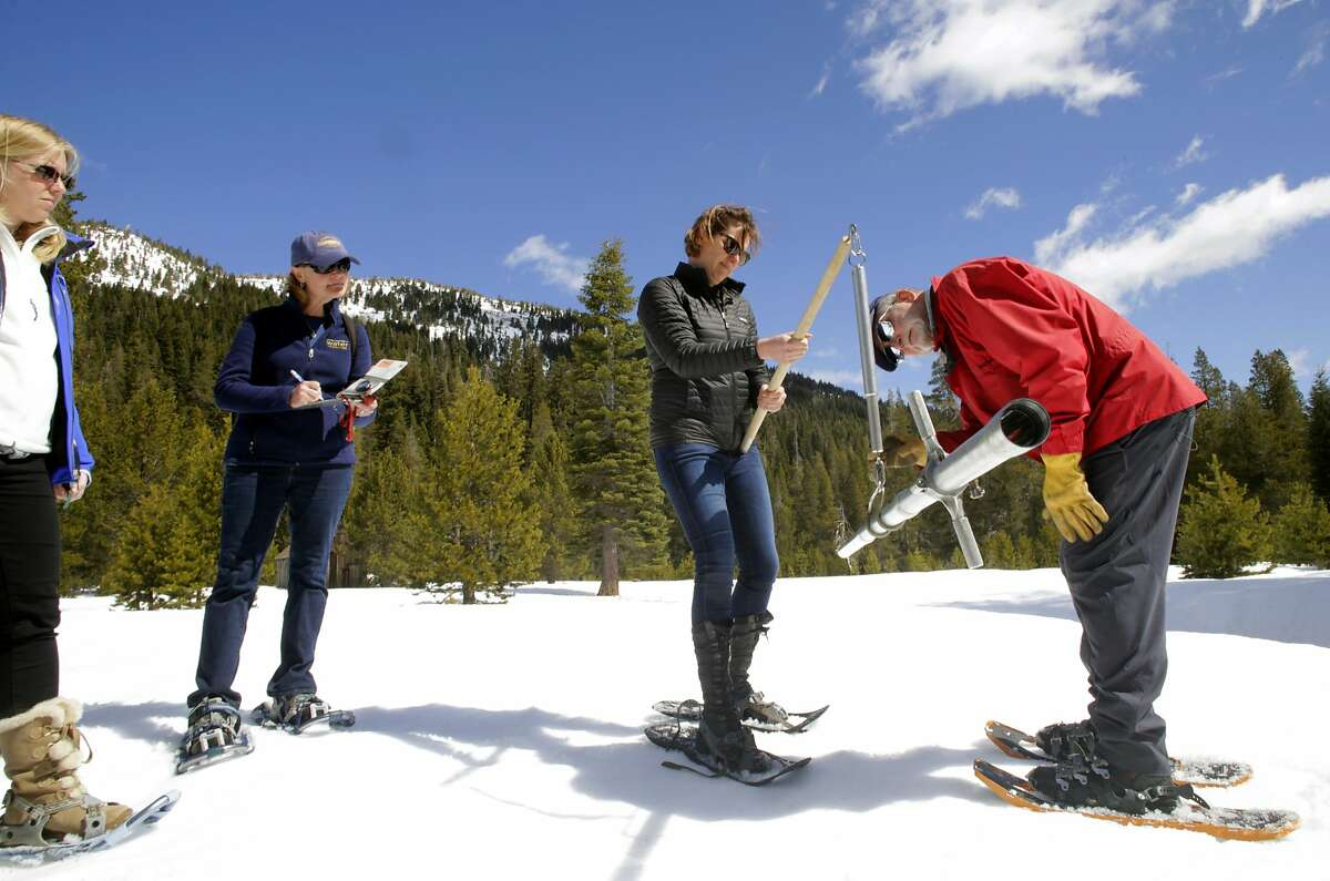 Frank Gehrke, chief of the California Cooperative Snow Surveys Program with help from the Director of the Department of Water Resoures Karla Nemeth as they take the final snow survey of the winter season at Phillips Station, Calif., as seen on Mon. April. 2, 2018.