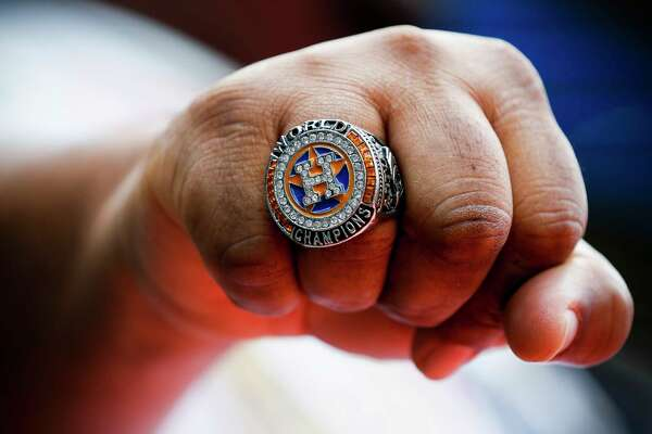 Houston Astros fan Tim Thorn shows off his replica World Series ring before the Astros home opener against the Baltimore Orioles at Minute Maid Park on Monday, April 2, 2018, in Houston.