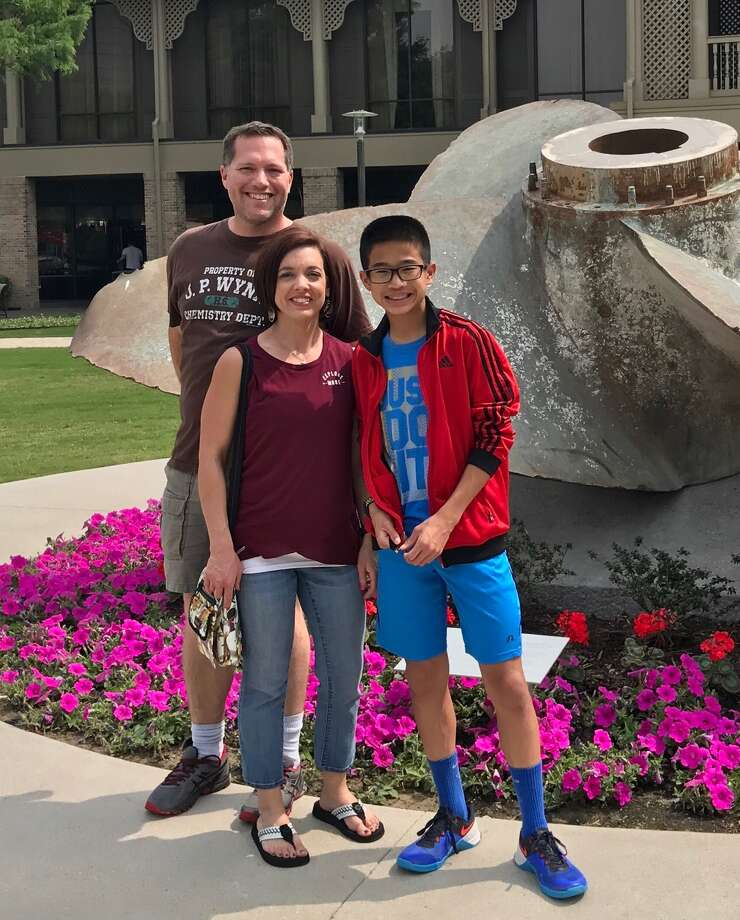 Caleb Lloyd is seen with his parents, Michael and Erin. Photo: Courtesy Photo