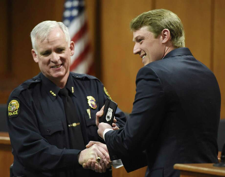 Police Chief James Heavey congratulates Steven Frano after he was sworn in as a Greenwich Police Officer at Town Hall in Greenwich, Conn. Monday, April 2, 2018. Frano will share the same badge number as his grandfather, John Frano, who was also a Greenwich police officer. Officer Brian Tornga was also promoted to Master Police Officer. Photo: Tyler Sizemore / Hearst Connecticut Media / Greenwich Time