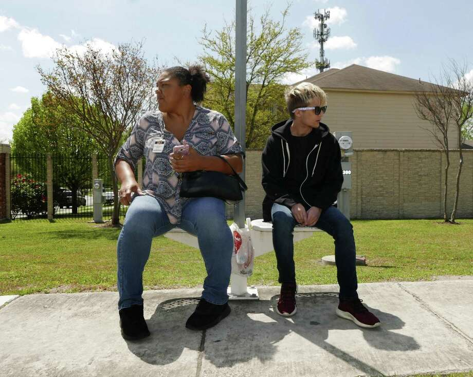 Charbonneau Bailey, left, who is an instructor in the Nellie M. Reddix Center's transportation training program, accompanies Sully Baxter, 20, on an outing to ride a VIA Metropolitan Transit bus along Potranco Road on Thursday, March 22, 2018. The program is designed to teach young adults with special needs and disabilities to use the bus system. Photo: Billy Calzada, Staff / San Antonio Express-News / San Antonio Express-News