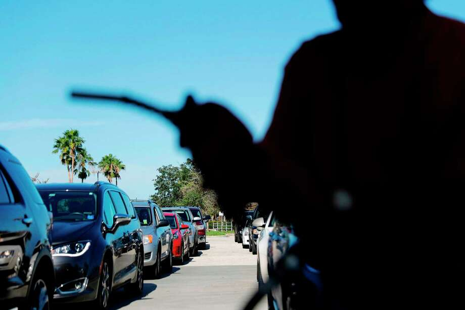 """FILE- In this Sept. 13, 2017, file photo, cars wait in line for gas as a station in Miromar Lakes, Fla. Environmental regulators announced on Monday, April 2, 2018, they will ease emissions standards for cars and trucks, saying that a timeline put in place by President Obama was not appropriate and set standards """"too high."""" (AP Photo/David Goldman, File) Photo: David Goldman / Copyright 2017 The Associated Press. All rights reserved."""
