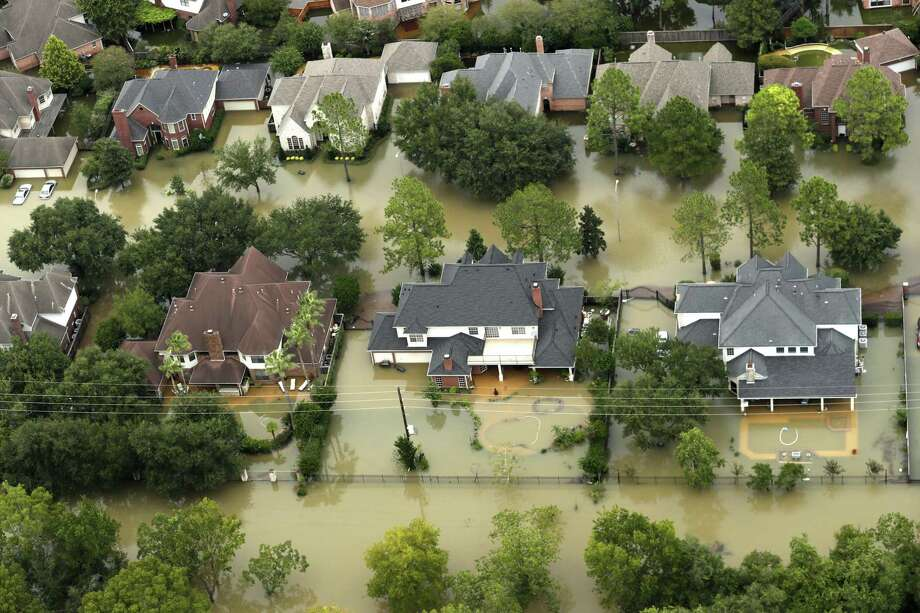 Floodwaters from the Addicks Reservoir inundate a neighborhood off N. Eldridge Parkway in Houston in the aftermath of Hurricane Harvey on Aug. 30, 2017. Photo: Brett Coomer, Staff / Houston Chronicle / © 2017 Houston Chronicle