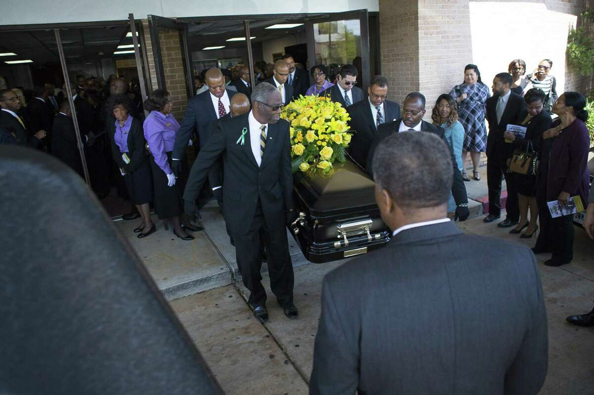 Houston City Councilman Larry Green's casket carried out of the church at the conclusion of a celebration of life service. Green's death of a drug overdose caught his colleagues at City Hall by surprise. ( Mark Mulligan / Houston Chronicle )