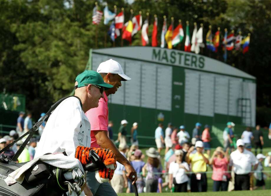 Tiger Woods, right, and caddie, Joe LaCava walk to the ninth green during practice for the Masters golf tournament at Augusta National Golf Club, Monday, April 2, 2018, in Augusta, Ga. (AP Photo/Charlie Riedel) Photo: Charlie Riedel, STF / Copyright 2018 The Associated Press. All rights reserved.