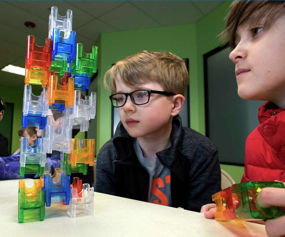 Noah Bishop, 11, left, and his brother Ari Bishop, 10, of Waterford check out some engineering work that was part of the April Break Camp at the Children's Museum of Science and Technology on Monday, April 2, 2018, in Troy, N.Y. (Skip Dickstein/Times Union) Photo: SKIP DICKSTEIN / 20043340A