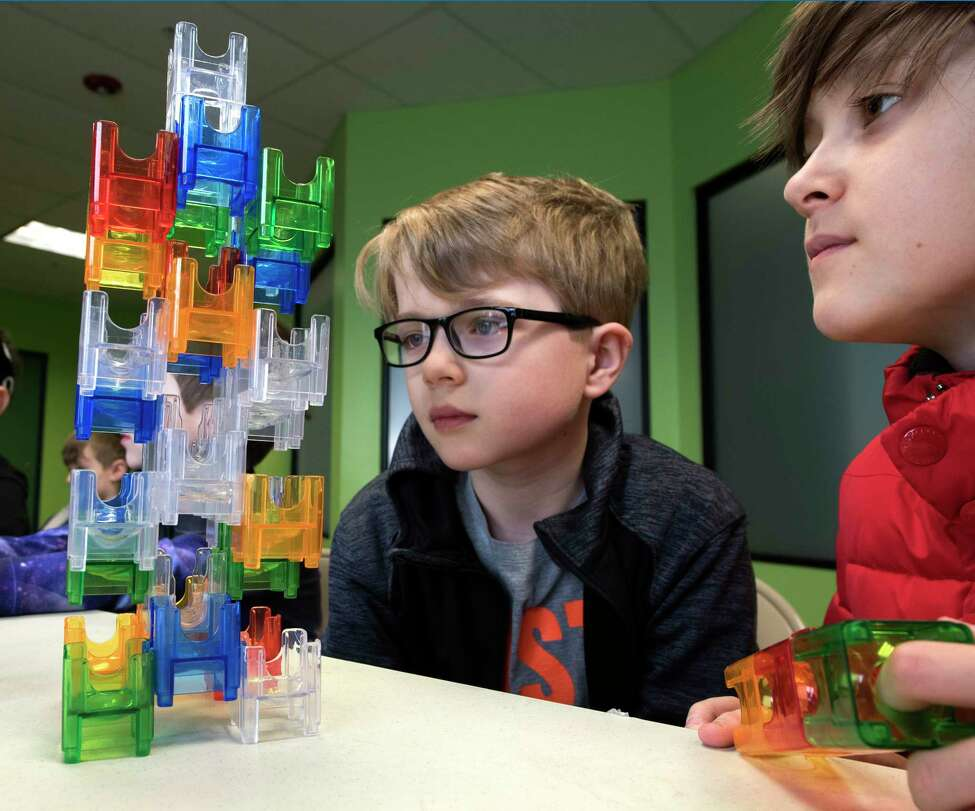 Noah Bishop, 11, left, and his brother Ari Bishop, 10, of Waterford check out some engineering work that was part of the April Break Camp at the Children's Museum of Science and Technology on Monday, April 2, 2018, in Troy, N.Y. (Skip Dickstein/Times Union)