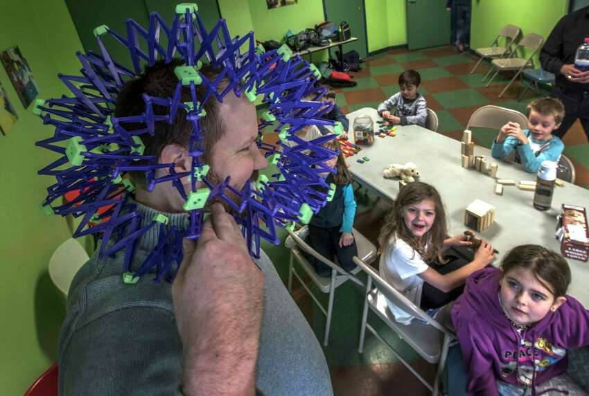 Museum educator Chris Hopkins wears a molecule as part of the discussion of molecular density during the April Break Camp at the Children's Museum of Science and Technology on Monday, April 2, 2018, in Troy, N.Y. (Skip Dickstein/Times Union)