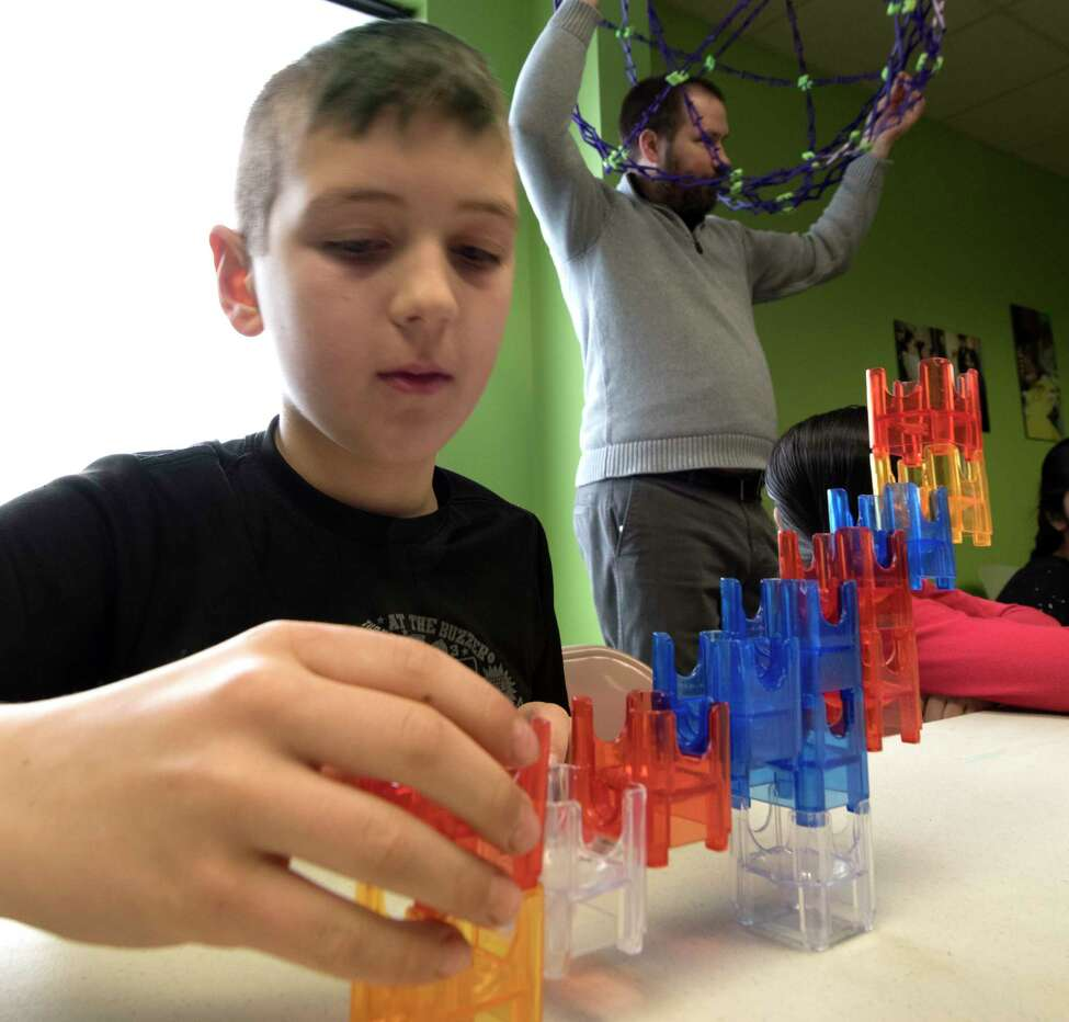One of the campers tries his hand at some engineering work that was part of the April Break Camp at the Children's Museum of Science and Technology on Monday, April 2, 2018, in Troy, N.Y. (Skip Dickstein/Times Union)