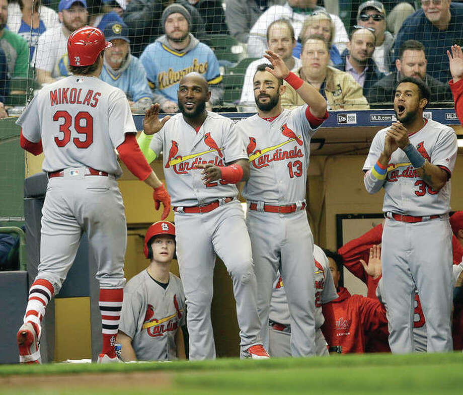 Cardinals pitcher Miles Mikolas (39) is welcomed back to the dugout after his two-run home run in the fifth inning of Monday's road win over the Milwaukee Brewers. Photo: AP