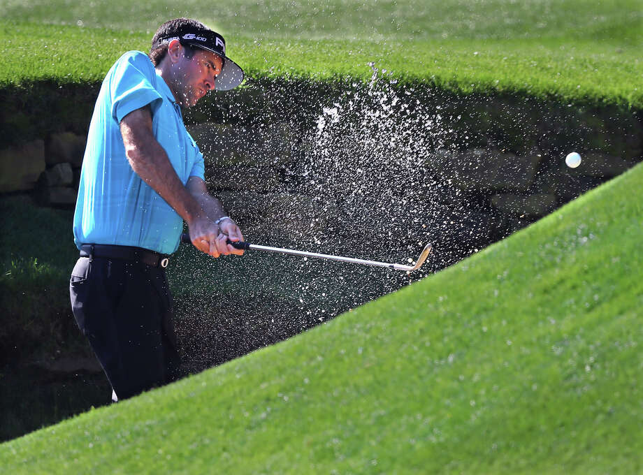 Bubba Watson chips from the creek to the 13th green during a practice round for the Masters golf tournament at Augusta National Golf Club in Augusta, Ga., Monday, April 2, 2018. (Curtis Compton/Atlanta Journal-Constitution via AP) Photo: Curtis Compton, AP / Atlanta Journal-Constitution