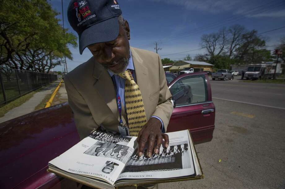 Tom Jones holds his college yearbook from Prairie View A&M, Wednesday, March 21, 2018, in Houston. Jones, who sang for Dr. Martin Luther King, Jr. as a member of the Prairie View A&M choir a month before Dr. King was assassinated in 1968, is organizing boys' choirs in four local schools through My Brother's Keeper Houston. ( Mark Mulligan / Houston Chronicle ) Photo: Mark Mulligan, Houston Chronicle / Houston Chronicle / © 2018 Houston Chronicle