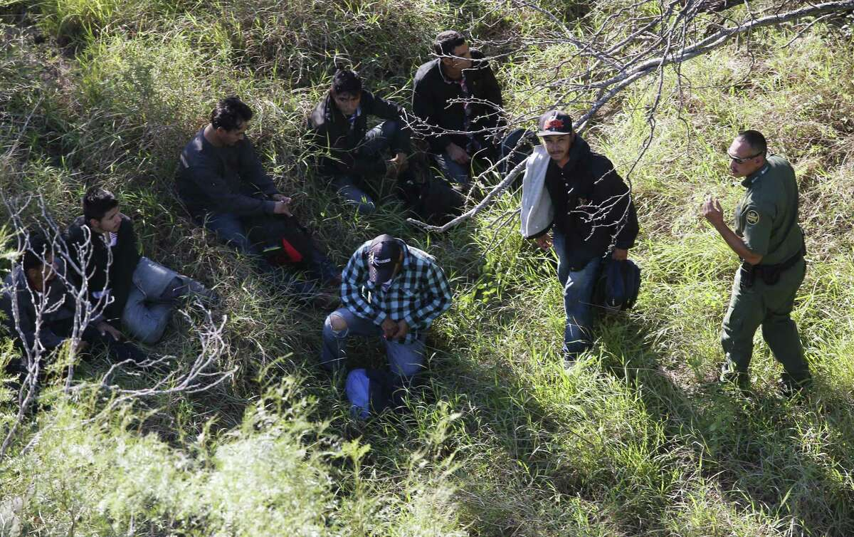 Border Patrol agents capture a group of undocumented immigrants hiding in brush on a ranch northeast of Rio Grande City in 2016.
