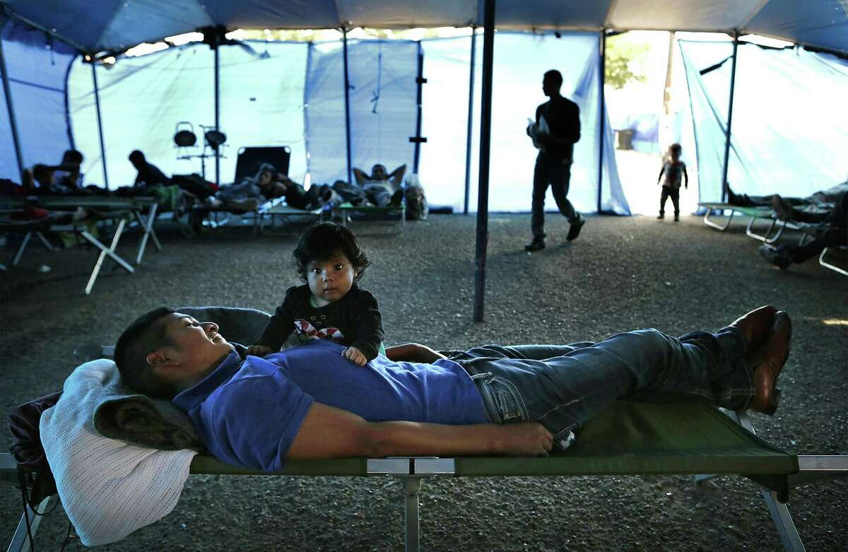 Fernando Pedro Luis Jesus of Guatemala rests in 2016 near daughter Juana Maribel Luis Mateo in a tent shelter in McAllen provided by a charity.