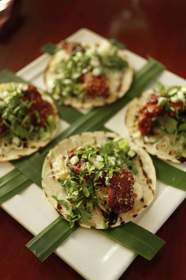 Chef David Cordua of the Corduas restaurants group created Korean Fried Chicken tacos, inspired by Mama Ninfa Laurenzo. He and his father, Michael Cordua, will participate in Tacos Over Texas on April 8. Photo: Karen Warren, Staff / Houston Chronicle / © 2018 Houston Chronicle
