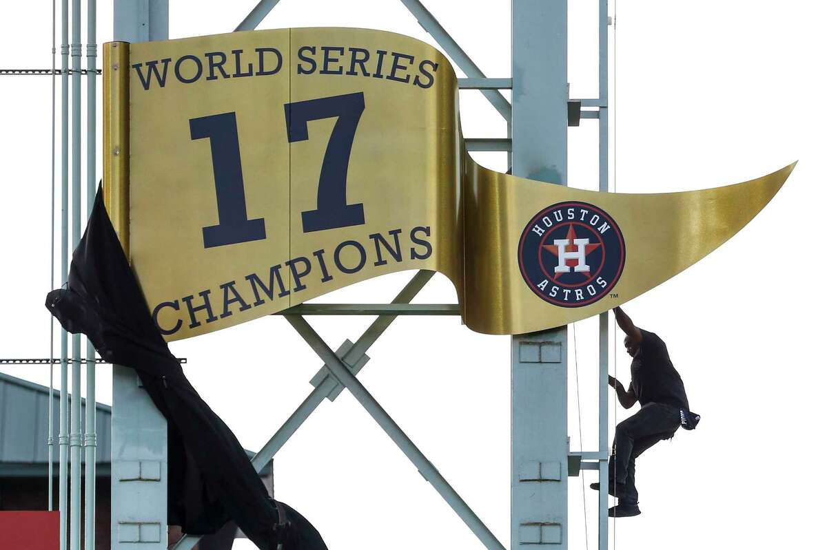 The World Series championship banner is unveiled during pregame ceremonies at the Astros home opener at Minute Maid Park on Monday, April 2, 2018, in Houston.