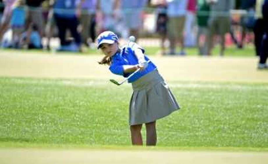 Raylee Bosley attempts to chip onto the green in the Girls' 7 to 9-year-old group during the Drive Chip & Putt National Finals at the Augusta National Golf Club at Augusta, Ga. Sunday. Raylee is the daughter of former longtime Memorial High basketball coach David Bosley. Photo: Drive Chip & Putt