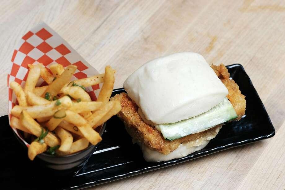 A Korean fried chicken sandwich with caramelized onions, roasted garlic aioli, pickled cucumber on a steam bun. Photo: PR Asian Art Museum /
