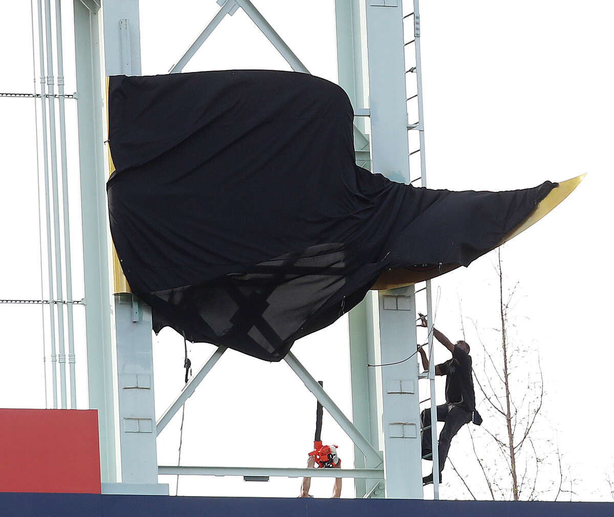 PHOTOS: A look at the World Series banner unveiling A worker shimmies up the ladder to free the tarp off the World Series penant during the pre-game ceremony before the start of the home opener during an MLB baseball game at Minute Maid Park, Monday, April 2, 2018, in Houston. Browse through the photos for a look at the World Series banner unveiling and all the other pregame festivities.