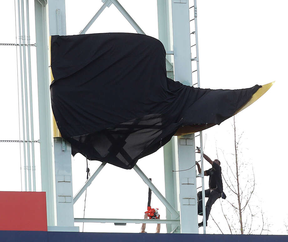 PHOTOS: A look at the World Series banner unveilingA worker shimmies up the ladder to free the tarp off the World Series penant during the pre-game ceremony before the start of the home opener during an MLB baseball game at Minute Maid Park, Monday, April 2, 2018, in Houston.Browse through the photos for a look at the World Series banner unveiling and all the other pregame festivities. Photo: Karen Warren, Houston Chronicle / © 2018 Houston Chronicle