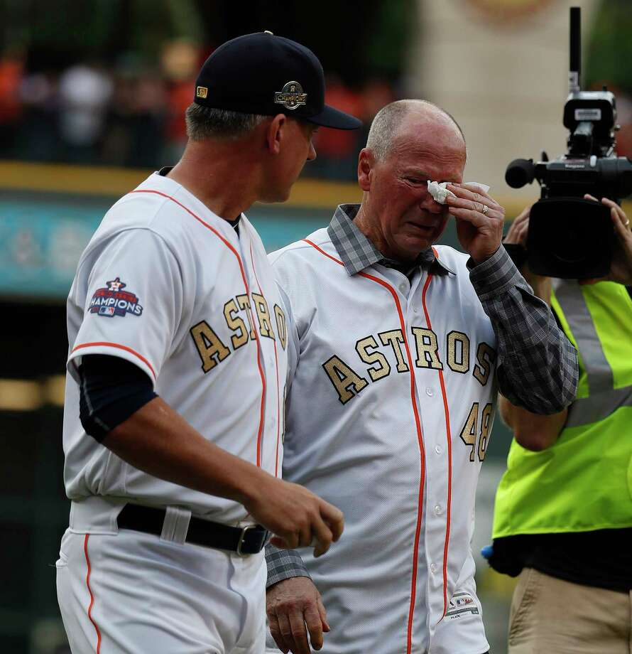 PHOTOS: A look at Rich Dauer's ceremonial first pitch before the Astros' home openerRich Dauer cries as he hugs manager AJ Hinch (14) after throwing out the first pitch during the pre-game ceremony before the start of the home opener during an MLB baseball game at Minute Maid Park, Monday, April 2, 2018, in Houston. Photo: Karen Warren, Houston Chronicle / © 2018 Houston Chronicle