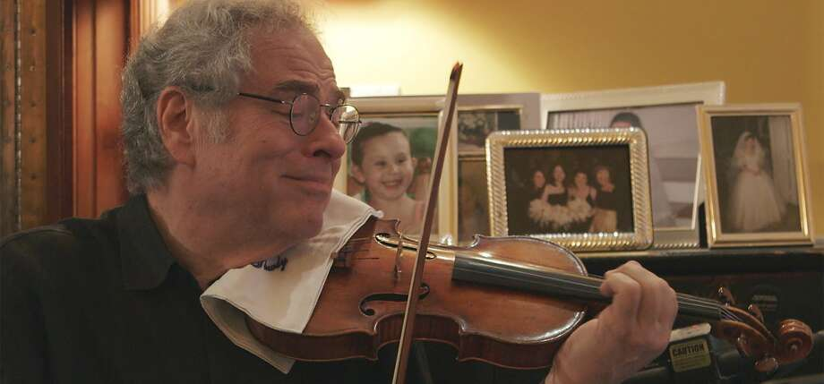 "Itzhak Perlman at home, in a scene from ""Itzhak."" Photo: Greenwich Entertainment"