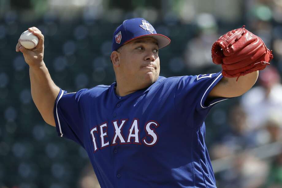 Texas Rangers starting pitcher Bartolo Colon throws against the Oakland Athletics during the first inning of a spring baseball game in Mesa, Ariz., Tuesday, March 6, 2018. (AP Photo/Chris Carlson) Photo: Chris Carlson / Associated Press