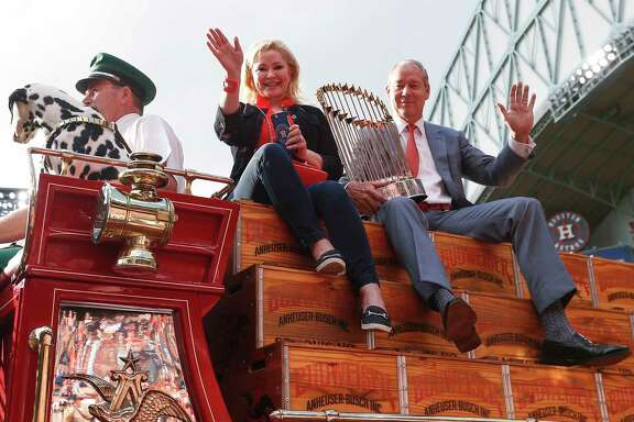 Houston Astros owner Jim Crane and his wife, Whitney, ride into the stadium with the World Series trophy during pregame ceremonies at the Astros home opener at Minute Maid Park on Monday, April 2, 2018, in Houston.