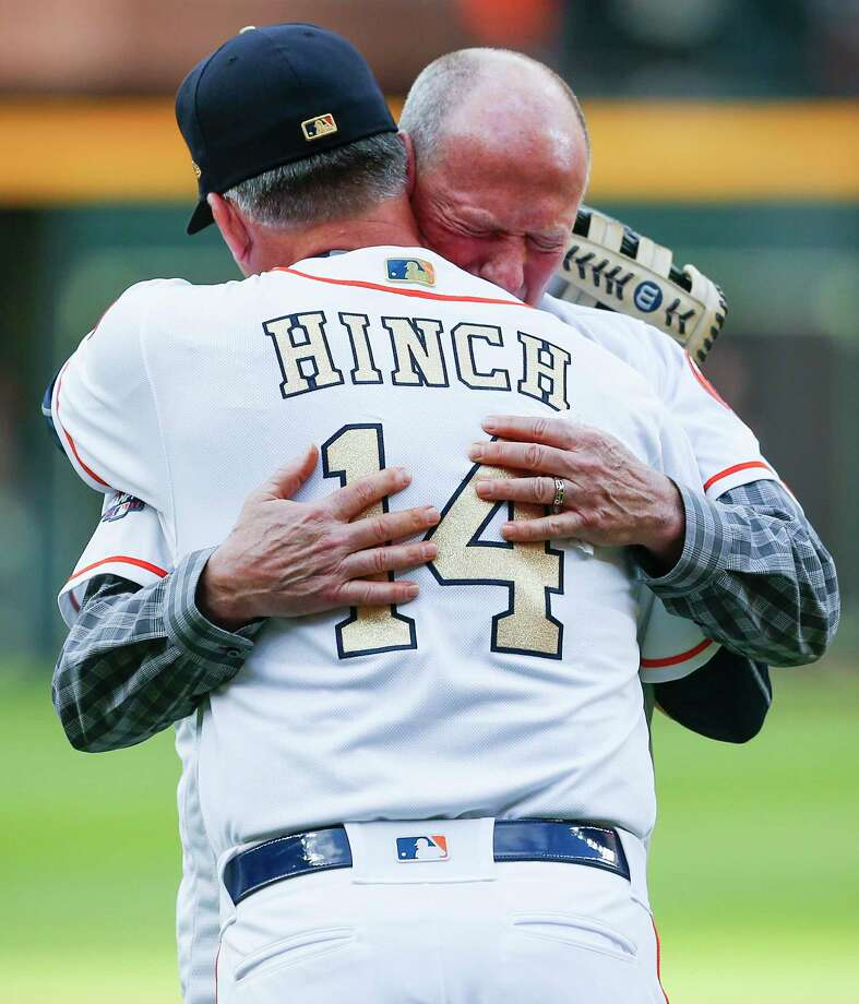 Former Houston Astros first base coach Rich Dauer embraces manager A.J. Hinch after throwing out the ceremonial first pitch during pregame ceremonies at the Astros home opener at Minute Maid Park on Monday, April 2, 2018, in Houston. Photo: Brett Coomer, Houston Chronicle / © 2018 Houston Chronicle