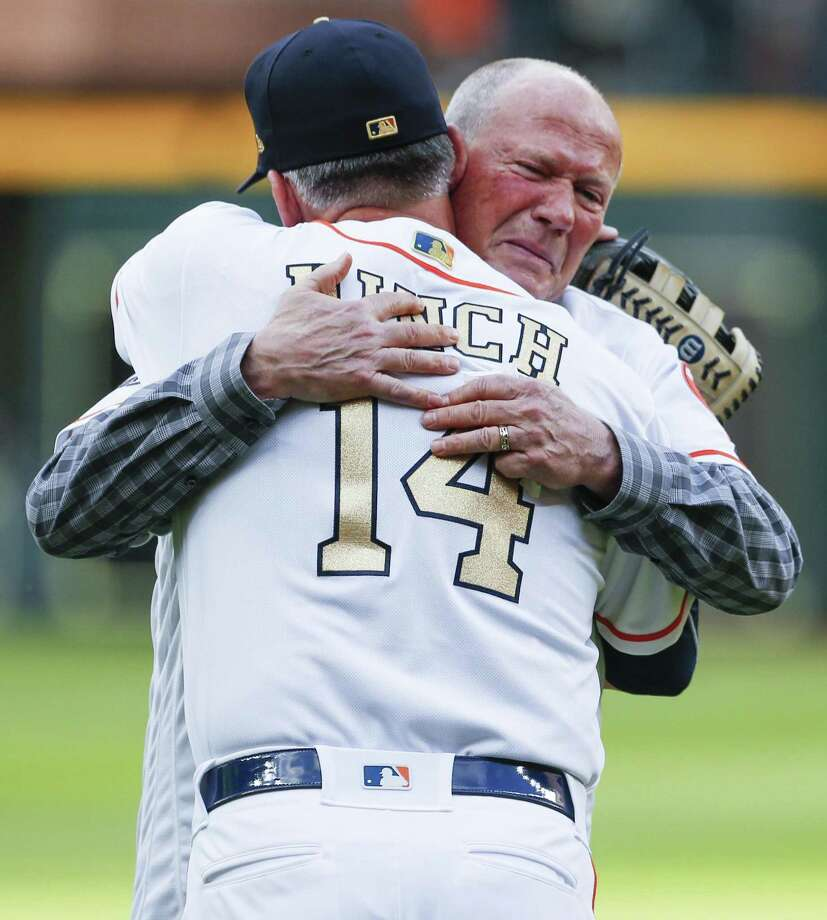 Former Houston Astros first base coach Rich Dauer embraces manager A.J. Hinch after throwing out the ceremonial first pitch during pregame ceremonies at the Astros home opener at Minute Maid Park on Monday, April 2, 2018, in Houston. ( Brett Coomer / Houston Chronicle ) Photo: Brett Coomer, Staff / Houston Chronicle / © 2018 Houston Chronicle