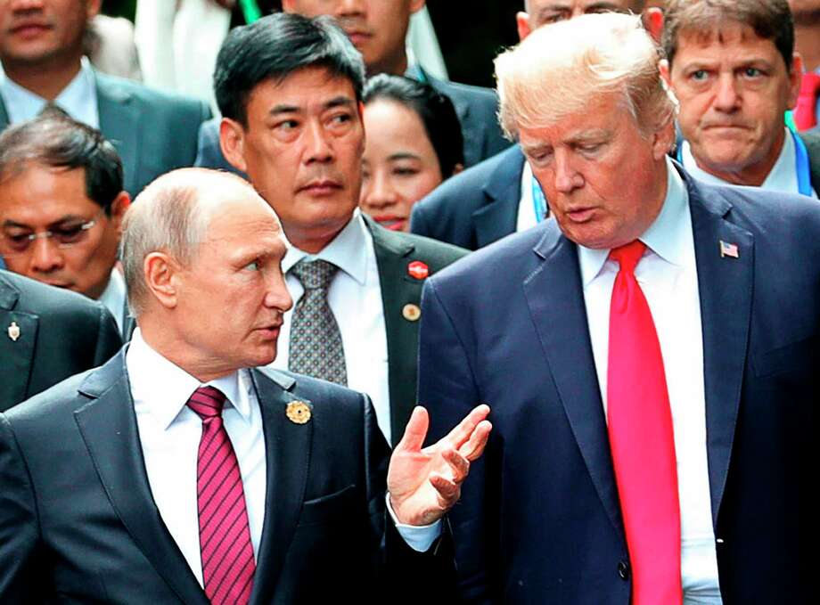 FILE - In this Nov. 11, 2017, file photo,  President Donald Trump, right, and Russia President Vladimir Putin talk during the family photo session at the APEC Summit in Danang. The Trump administration is opening the door to a potential White House meeting between Trump and Putin. It would be the first time Putin has been at the White House in more than a decade and come at a time of rising tensions between the two global powers. (Mikhail Klimentyev, Sputnik, Kremlin Pool Photo via AP) Photo: Mikhail Klimentyev / POOL SPUTNIK KREMLIN