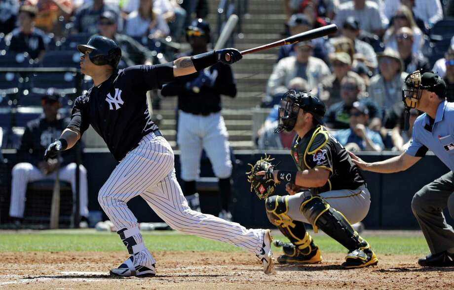 New York Yankees' Gary Sanchez follows through on his three-run home run off Pittsburgh Pirates' Brett McKinney during the third inning of a spring training baseball game Thursday, March 15, 2018, in Tampa, Fla. Yankees' Aaron Judge, and Giancarlo Stanton scored. Catching for the Pirates is Francisco Cervelli. (AP Photo/Chris O'Meara) Photo: Chris O'Meara / Copyright 2018 The Associated Press. All rights reserved.