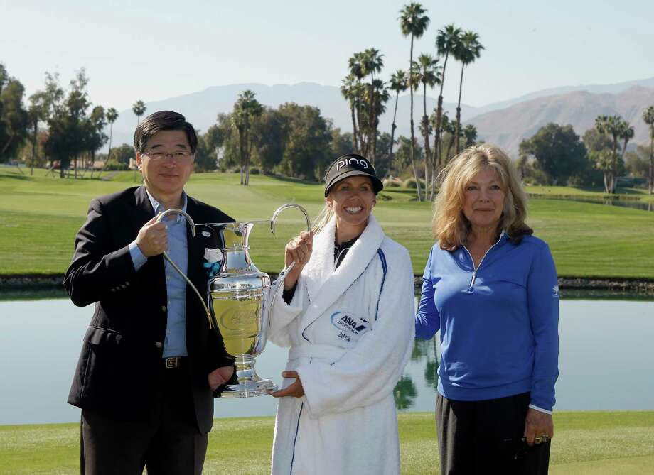 ANA Vice President Hideki Kunugi, left, and Melissa Montgomery, right, daughter of Dinah Shore, present the trophy to Pernilla Lindberg, of Sweden, for winning the LPGA Tour ANA Inspiration golf tournament on the eighth playoff hole at Mission Hills Country Club in Rancho Mirage, Calif., Monday, April 2, 2018. (AP Photo/Alex Gallardo) Photo: Alex Gallardo / FR170211 AP
