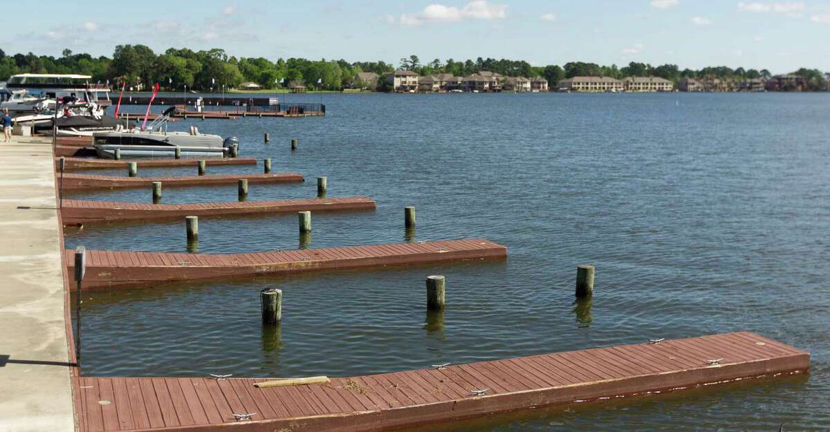 Docks that were covered by water a day earlier, are seen as lake levels receded enough for the San Jacinto River Authority to reopened Lake Conroe at noon Saturday, March 31, 2018. Officials urged boaters to use extreme caution due to floating debris and submerged objects that are not be fully visible.
