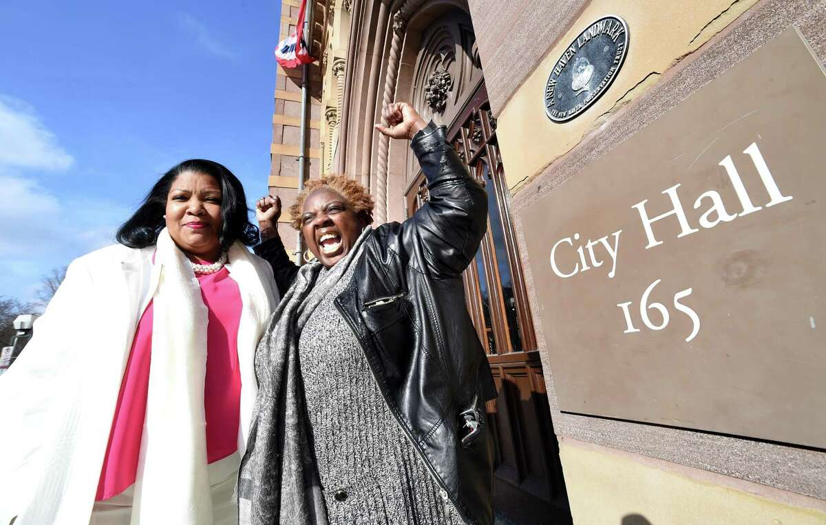 Nichole Jefferson, left, in front of City Hall in New Haven Monday with Cherlyn Poindexter, former union president of Local 3144.