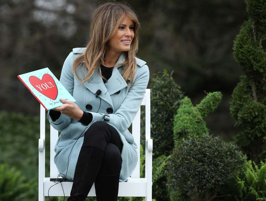 U.S. First Lady Melania Trump reads a children's book during the Easter Egg Roll on the South Lawn of the White House in Washington, Washington, D.C., U.S., on Monday, April 2, 2018. President Donald Trump and Melania hosted the 140th Easter Egg Roll at the White House Monday, this after Trump spent Easter Sunday tweeting about ending the Obama-era DACA deal and pulling out of NAFTA if Mexico does not increase security at the border. Photographer: Chip Somodevilla/Pool via Bloomberg Photo: Chip Somodevilla / © 2018 Bloomberg Finance LP