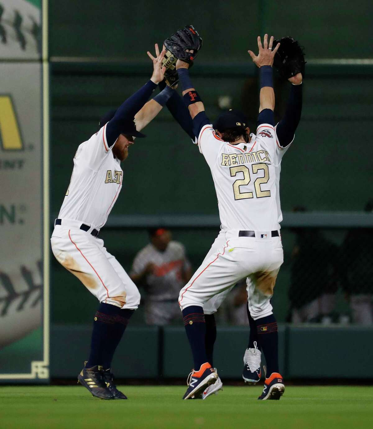 Houston Astros Josh Reddick (22), Derek Fisher (21), and George Springer (4) celebrate the Astros win over Baltimore Orioles after the home opener MLB baseball game at Minute Maid Park, Monday, April 2, 2018, in Houston.