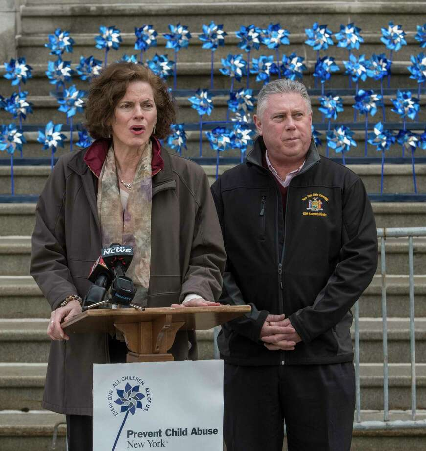 Assemblyman John McDonald, right and Assemblywoman Pat Fahy speak at the kick-off the Pinwheel campaign by Prevent Child Abuse New York which brings awareness to the problem of child abuse in New York State at the State Capitol on Monday, April 2, 2018 in Albany, N.Y. (Skip Dickstein/Times Union) Photo: SKIP DICKSTEIN / 40043376A