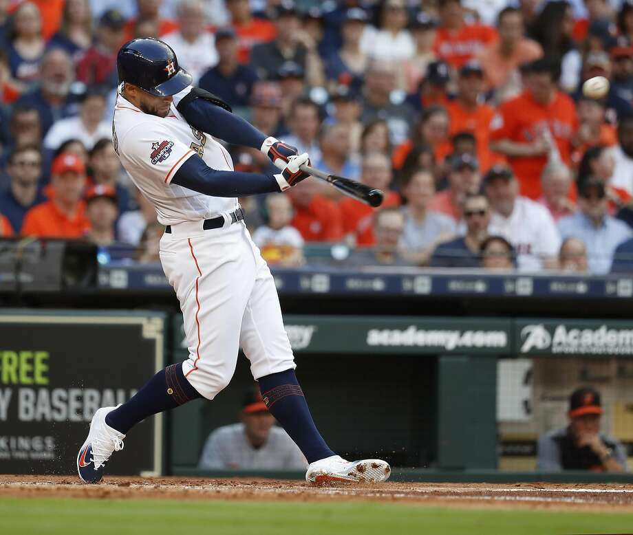 Houston Astros center fielder George Springer (4) hits a lead off double in the first inning of the home opener MLB baseball game at Minute Maid Park, Monday, April 2, 2018, in Houston. Photo: Karen Warren, Houston Chronicle