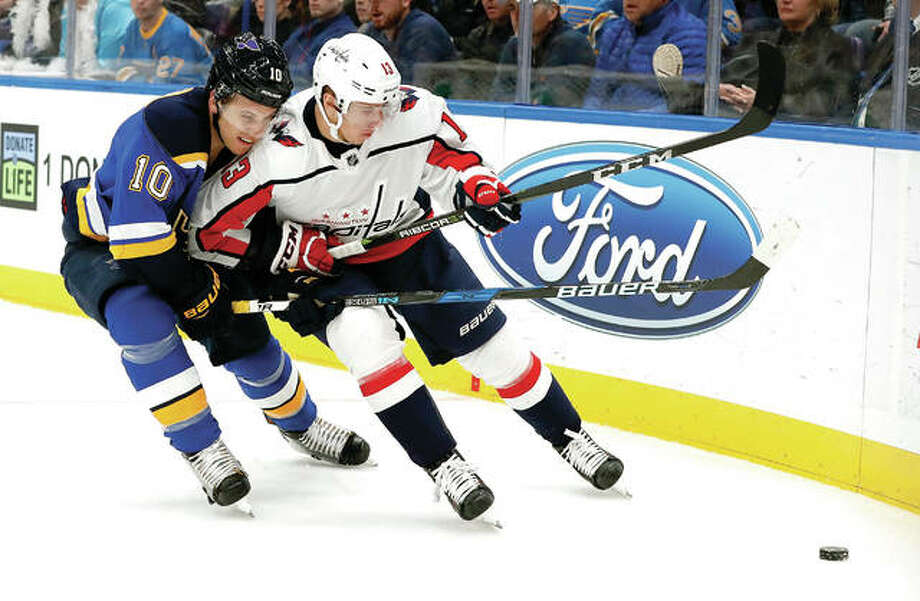 The Blues' Brayden Schenn (10) and Washington Capitals' Jakub Vrana chase a loose puck along the boards during Monday's game in St. Louis. The Capitals won 4-2. Photo: AP