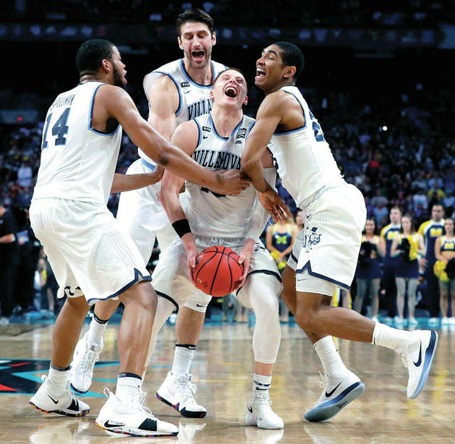 Villanova guard Donte DiVincenzo, center, celebrates with teammates at the end of the championship game against Michigan in the Final Four NCAA college basketball tournament, Monday, April 2, 2018, in San Antonio. Villanova won 79-62. Photo: David J. Phillip | AP Photo