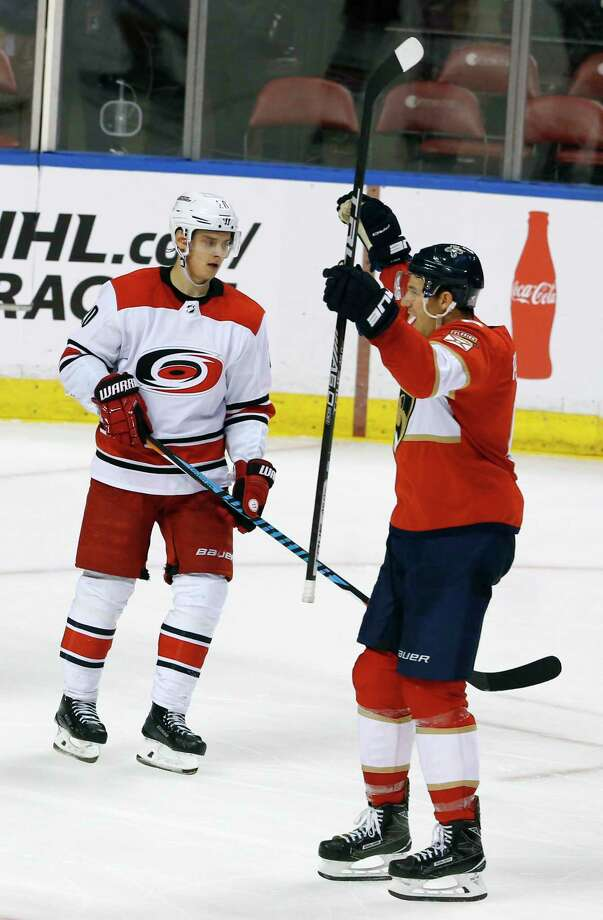 Florida Panthers defenseman Alexander Petrovic (6) celebrates his game-winning goal in the third period in front of Carolina Hurricanes right wing Sebastian Aho (20) during an NHL hockey game, Monday, April 2, 2018, in Sunrise, Fla. The Panthers won the game 3-2. (AP Photo/Joe Skipper) Photo: Joe Skipper / FR171174 AP